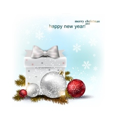 Beautiful christmas balls and gift on snow xmas vector