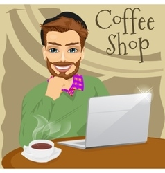 Handsome hipster man with laptop in coffee shop vector