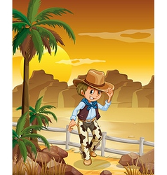 A young cowboy at the desert vector