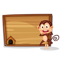 A monkey beside an empty board vector image vector image