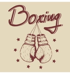 Vintage label with old boxing gloves vector image