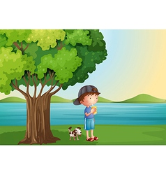 A young boy and his pet under the tree vector image vector image