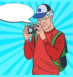 Mature man taking picture with camera pop art vector