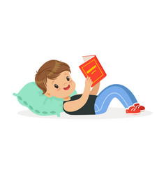 Cute little boy lying on a pillow and reading a vector