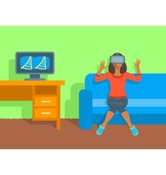 African woman in virtual reality glasses at home vector