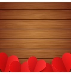 wooden background with red paper hearts vector image