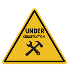 Under construction triangular warning sign on vector