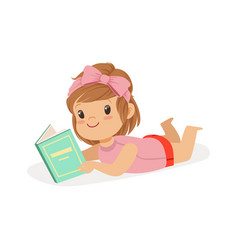 sweet little girl lying on her stomach and reading vector image vector image