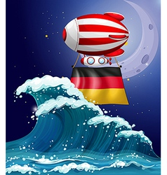 An air balloon with the flag of germany vector