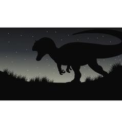 Silhouette of dilophosaurus at night vector