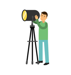 man controlling studio lighting equipment on a vector image