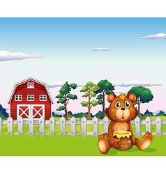 A bear sitting outside the fence at the farm vector