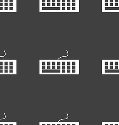Computer keyboard icon seamless pattern on a gray vector