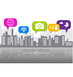 Social media icons over silhouette city background vector