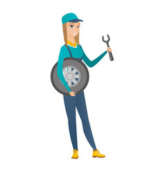 Young mechanic with tyre and spanner vector