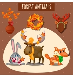 Three forest animals in a warm scarf and hat vector
