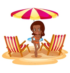 A tan lady at the beach near the beach umbrella vector