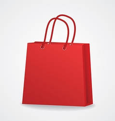 Realistic red shopping bag with rope handles on vector