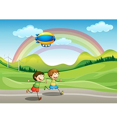 Kids running with an airship above vector image vector image