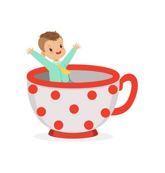 Cute little boy sitting in a cup kid have a fun vector
