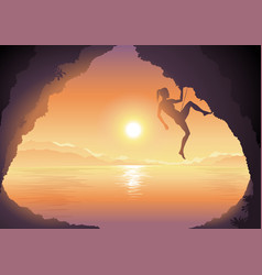 woman climbing on a cliff beautiful sunset vector image