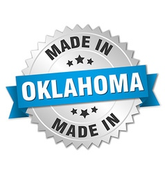 Made in oklahoma silver badge with blue ribbon vector