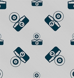 retro photo camera icon sign Seamless pattern with vector image