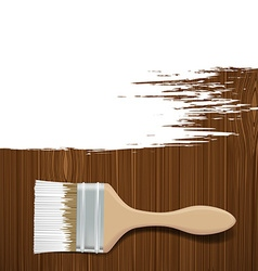 Paintbrush with white paint on a wooden surface vector