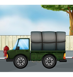 A green track with a cargo at the back vector image vector image