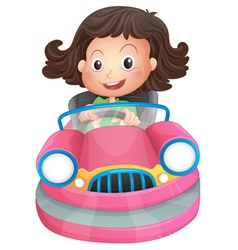 A young girl riding on a pink bumpcar vector image