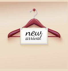 Clothes hanger with new arrival tag vector