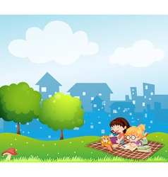 Girls reading at the hill across the village vector image vector image