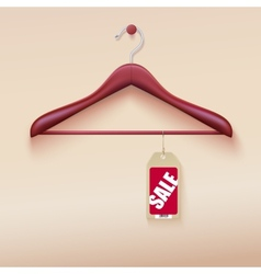Red tag with sale sign hanging on wooden hanger vector