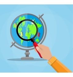 Globe with continents and magnifying glass vector