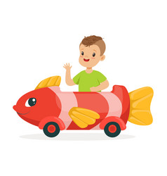 cute little boy riding on toy fish car kid have a vector image