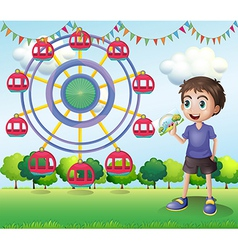 A boy holding a picture vector image
