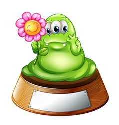 A green monster holding a flower vector image vector image