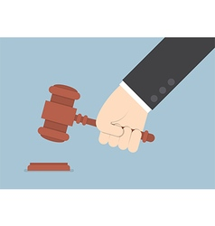 Businessman hand knocking judge gavel vector