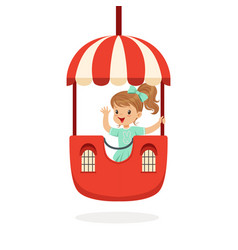 Cute little girl riding a colorful carousel kid vector