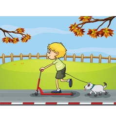 A boy riding with his scooter followed by his pet vector image