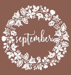 Hand drawn september sign with wreath on brown vector
