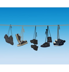 The footwear hanging on a rope vector