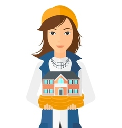 Woman holding house model vector