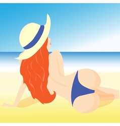 a girl lying on the beach in shorts and hat vector image