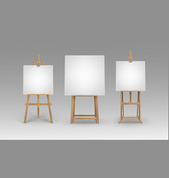 Set of wooden easels with empty canvases vector
