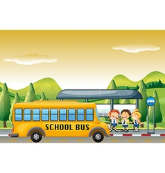 Children getting on school bus at bus stop vector image