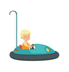 Cute little boy riding bumper car kid have a fun vector