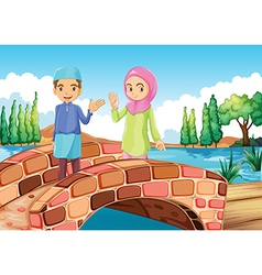 A muslim couple waving at the bridge vector