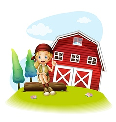 A girl sitting in front of a red barnhouse vector image