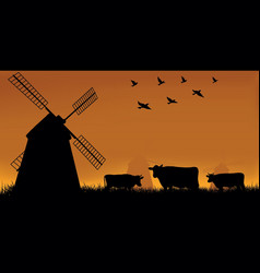mill and cow on a meadow vector image